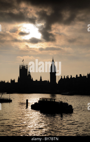 River Thames with the Houses of Parliament  in silhouette ,London - Stock Photo
