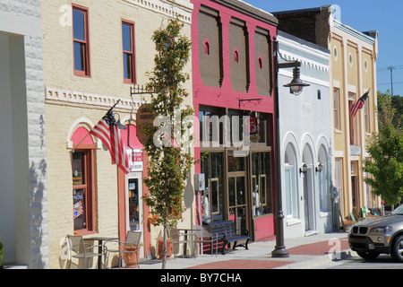 Georgia Flowery Branch small town community main street business cafe store front painted facade restoration revitalization - Stock Photo