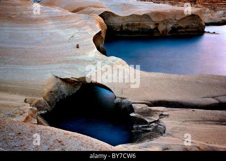 Milos island, volcanic rocks in Sarakiniko beach (slow shutter speed). - Stock Photo