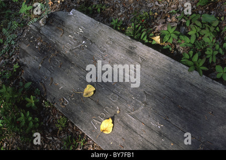 Decaying wooden grave marker at a pioneer cemetery in Dawson City, Canada - Stock Photo