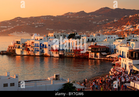 Famous 'Little Venice' in the Hora of Mykonos, around sunset - Stock Photo