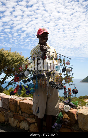 Man, street vendor artist, selling handicrafts in Hout Bay - Stock Photo