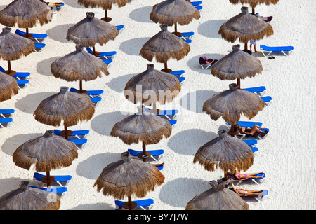 Parasols on the beach in Cancun, Mexico - Stock Photo