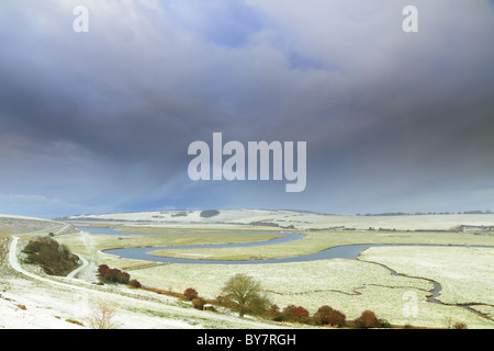 Snow clouds gather over the Cuckmere Valley, Exceat Nr Eastbourne, East Sussex, England. - Stock Photo