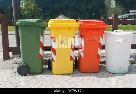 Trash Containers for Garbage Separation: plastic, glass, aluminum, paper and food - Stock Photo
