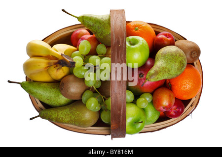 Photo of a wooden trug full of fresh fruit, shot from above and isolated on a white background. - Stock Photo