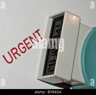Rubber Stamp - Urgent - Stock Photo