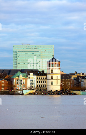 Dusseldorf, Schlossturm tower at the Altstadt and Rhine embankment, Dreischeibenhaus building in background - Stock Photo