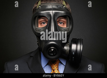 Businessman Wearing Gas Mask - Stock Photo