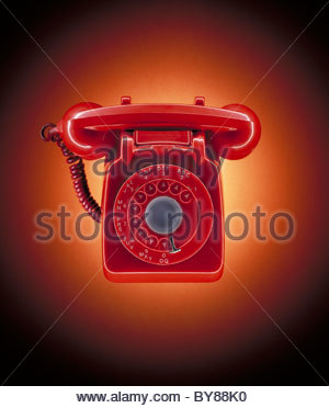 Close up of red, old-fashioned telephone - Stock Photo