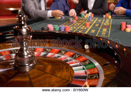 Close up of ball spinning on roulette wheel - Stock Photo