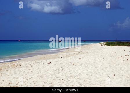 View along the quiet white sandy beach, Bridgetown, Barbados, Caribbean. - Stock Photo