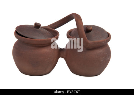 Two earthenware pots with handle and lids - Stock Photo