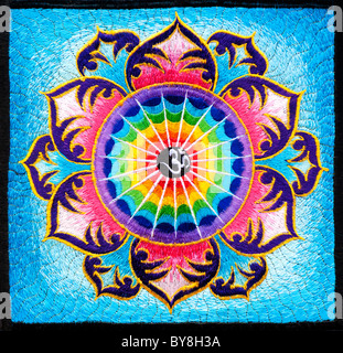 Multicoloured Hindu OM / AUM and lotus flower embroidery pattern. Indian handicraft. India - Stock Photo
