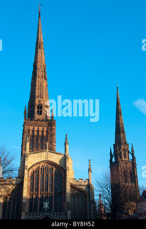 Holy Trinity Church spire in the foreground with the old Coventry Cathedral (St Michaels) to the rear. West Midland, - Stock Photo