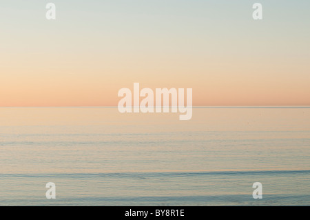 A Flat calm sea at dusk - Cardigan Bay west wales UK - Stock Photo