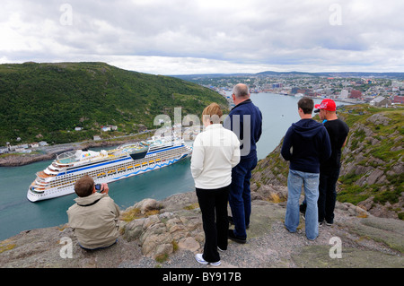 Locals And Tourist's Watching A Cruise Ship Entering St John's - Stock Photo