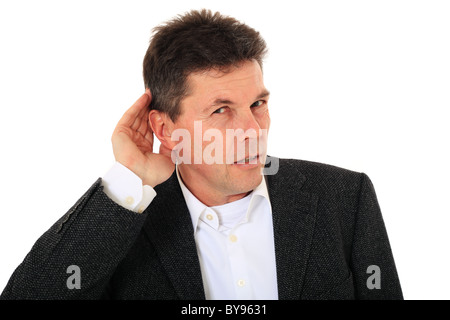 Attractive middle-aged man cannot hear anything. All on white background. - Stock Photo