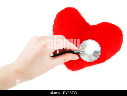 Hand with stethoscope checking a red heart isolated - Stock Photo