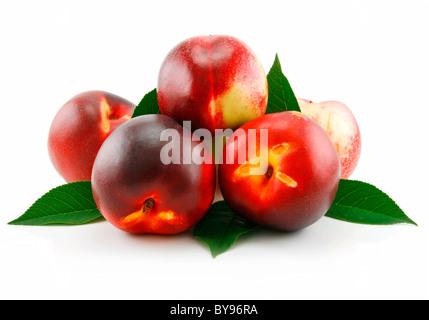 Ripe Peach (Nectarine) with Green Leafs - Stock Photo