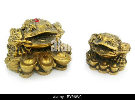 Statuette of two frogs with chinks isolated - Stock Photo