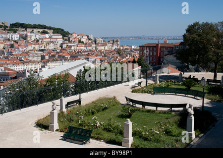 The view across the rooftops of Lisbon from the gardens at Bairro Alto. The gardens can be reached by the Elevador - Stock Photo