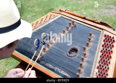Traditional folk musician playing the hammered dulcimer - Stock Photo