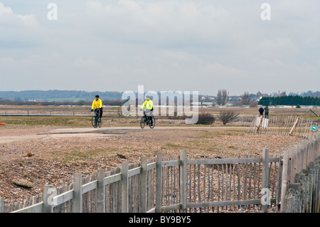 Cyclist On A Winters Day Rye Harbour Nature Reserve East Sussex England - Stock Photo