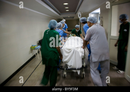 Surgeons taking a patient to an operation theatre - Stock Photo
