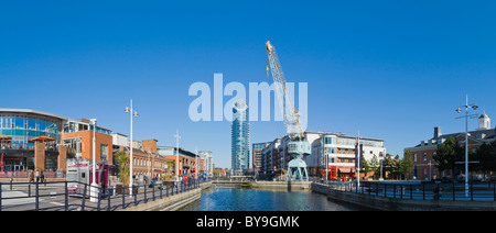 Panorama of Gunwharf Quays with dock crane and The Number One Tower or Lipstick, Portsmouth, Hampshire, England, - Stock Photo