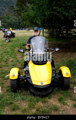 three wheeled motor scooter man on a quadro 350s tilting three stock photo royalty free image. Black Bedroom Furniture Sets. Home Design Ideas