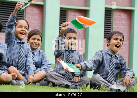 School kids holding the Indian flag - Stock Photo