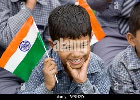 School boy holding the Indian Flag - Stock Photo