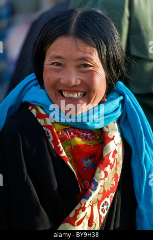 Beautiful smiling Tibetan young woman pilgrim with blue scarf in the Barkhor Lhasa Tibet. JMH4641 - Stock Photo