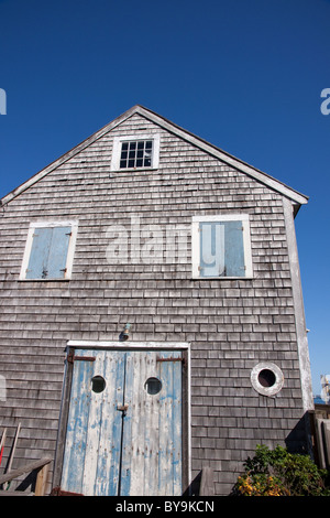 Weathered, old, rustic, cedar shingled house on Cape Cod. - Stock Photo