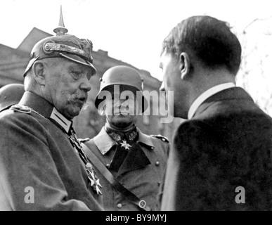 PAUL VON HINDENBURG Prtesident of German with Hitler at right and Werner von Blomberg in  Potsdam 21 March 1933 - Stock Photo