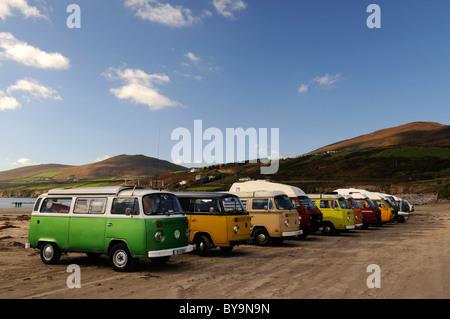 line row of Volkswagen beetle vans vintage retro transport surf surfing culture Inch beach county kerry ireland - Stock Photo