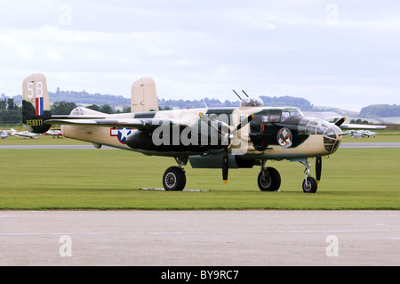 North American B-25J Mitchell in USAAF camouflage on the flightline at Duxford airfield - Stock Photo