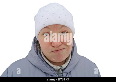Bewilderment and doubt on a woman's face, is isolated, a white background, winter in Moscow Region, Russia - Stock Photo