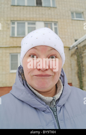 Surprise, delight and desire on a woman's face, winter in the street in Moscow Region, Russia - Stock Photo