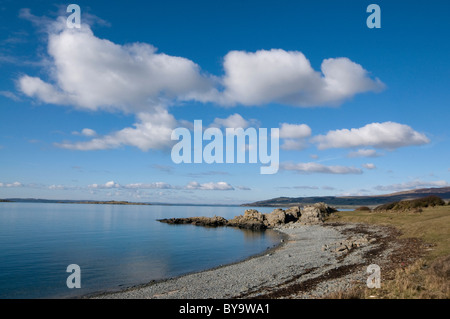 Carrick Shore with rocky spit and big blue sky, Galloway and Fleet Bay - Stock Photo