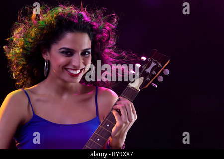 Portrait of a woman with a guitar - Stock Photo