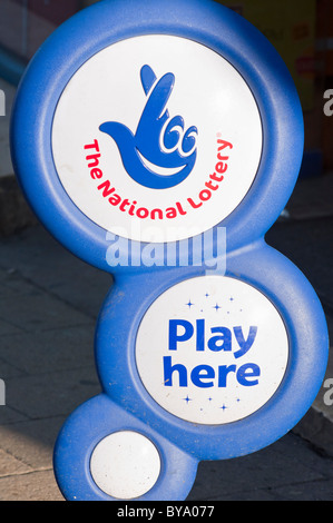 National lottery sign outside a Newsagents in the UK. - Stock Photo