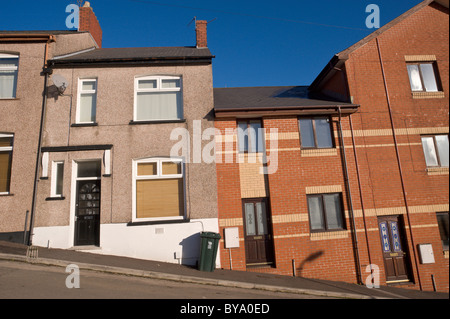 Old and new built terraced houses on hill in Newport South Wales UK - Stock Photo