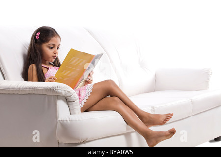 Little girl reading a story book - Stock Photo