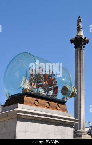 Nelsons flagship Victory in a bottle on the fourth plinth in Trafalgar Square with Nelsons column beyond London - Stock Photo