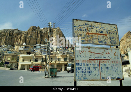 Signs giving directions to the Mar Sarkis and Mar Taqla convents in the village of Maaloula / Ma'loula, Syria. - Stock Photo