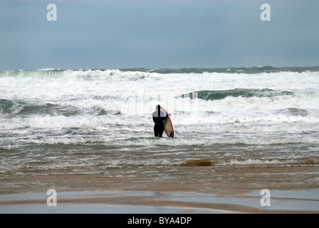 surfing on a cold winters day in Cornwall, England - Stock Photo