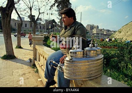 Syria, Aleppo - street vendor selling tea on the sidewalk - Stock Photo