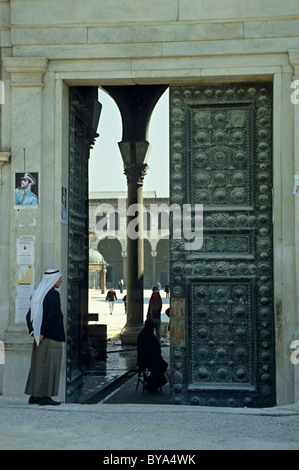 Man wearing a keffiyeh standing outside the Umayyad Mosque in Damascus, Syria. - Stock Photo